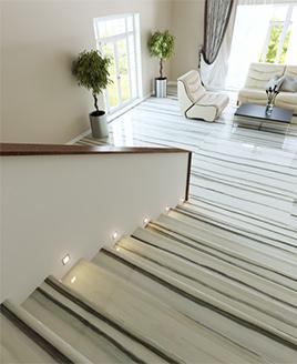 Отделка лестницы из керамогранита под мрамор ступени Zebrino